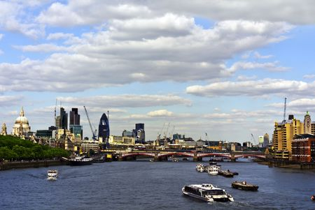 City of London view from Waterloo Bridge. This view includes: St. Paul`s Cathedral, The Gherkin, Tower 42, Blackfriars Bridge and Canary Wharf.  photo