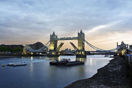 Opened Tower Bridge at sunset, London photo
