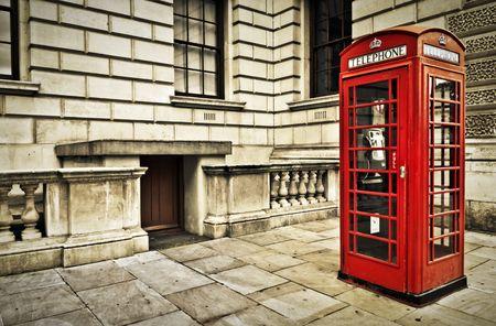 Classic red British telephone box in London photo