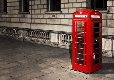telephone booth: Classic red British telephone box in London