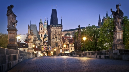 st charles: View of the Lesser Bridge Tower of Charles Bridge in Prague  Karluv Most  at dawn, Czech Republic