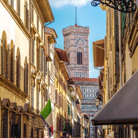 Street of Florence with the tower of  Santa Maria Del Fiore in the back Tuscany, Italy