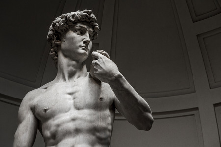 italian people: David by Michelangelo in Galleria dellAccademia Uffizi Museum, Florence. Italy.