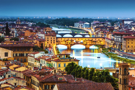 Florence, Ponte Vecchio arch bridge at twilight from Piazzale Michelangelo Tuscany, Italy