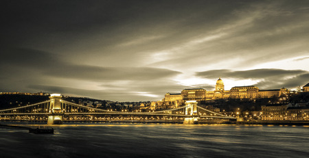 the chain bridge: Hungarian landmarks, Chain Bridge, Royal Palace and Danube river in Budapest at night. Editorial