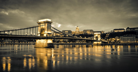 man made structure: Hungarian landmarks, Chain Bridge, Royal Palace and Danube river in Budapest at night. Editorial