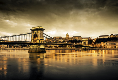 buda: Hungarian landmarks, Chain Bridge, Royal Palace and Danube river in Budapest at night. Editorial