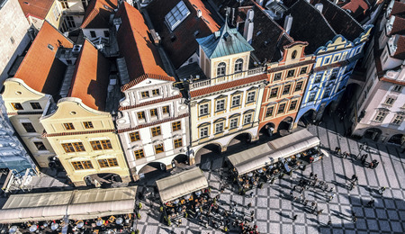 old town square: Row houses with traditional red roofs in Prague Old Town Square in the Czech Republic