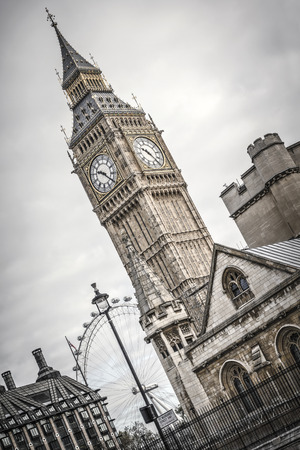 typically english: Big Ben and the London Eye in the background.
