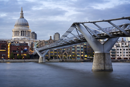 typically english: City of London, Millennium bridge and St. Pauls cathedral at twilight