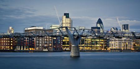 stock exchange: Financial District and Millennium Bridge, London. This view includes :Tower 42 Gherkin,Willis Building, and Stock Exchange Tower and Millennium Bridge.