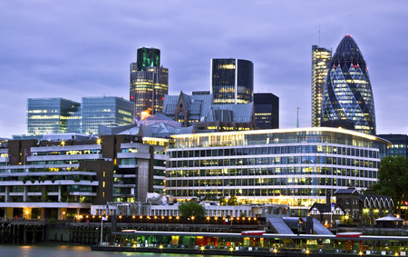 lloyd's of london: London skyline seen from the River Thames at twilight