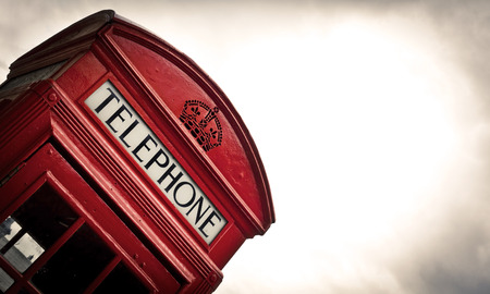 old phone: Classic red British telephone box in London