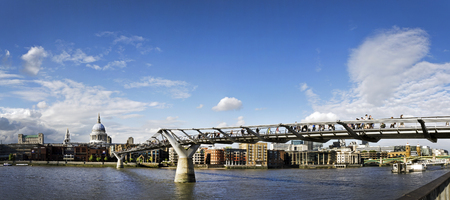 millennium bridge: St. Pauls cathedral and the Millennium bridge London, England. Stock Photo