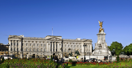 buckingham: Victoria Memorial and Buckingham Palace London, home to the Queen of England. Clear deep blue summer sky.