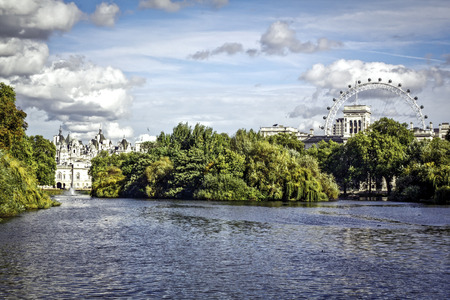 green park: St. James Park lake with Horse Guards and London Eye in the background.