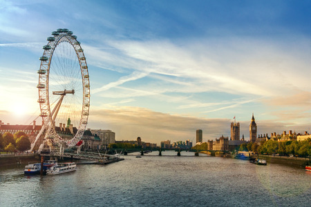 London morning sunrise. London eye, County Hall, Westminster Bridge, Big Ben and Houses of Parliament.