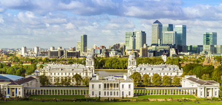 London's National Maritime Museum and skyscrapers of Canary Wharf from Greenwich park