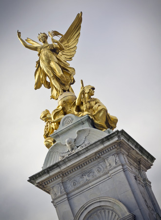 palace: Nike Goddess of Victory Statue on the Victoria Monument Memorial outside Buckingham Palace, London