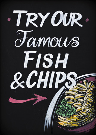british english: Close up of a traditional British pub sign. Fish and Chips