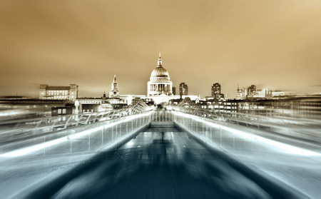 millennium: Millennium Bridge leads to Saint Pauls Cathedral in central London at night Stock Photo