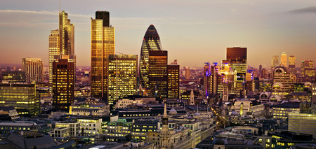 twilight: City of London one of the leading centres of global finance.This view includes Tower 42 Gherkin,Willis Building, Stock Exchange Tower and Lloyds of London and Canary Wharf at the background. Stock Photo