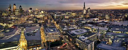 London at twilight panoramic view from St. Paul's Cathedral. City of London one of the leading centres of global finance. This view includes Tower 42 Gherkin,Willis Building, Stock Exchange Tower, Canary Wharf,  Tower Bridge and a construction of Shard Lo