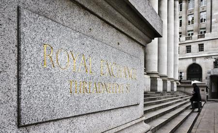 trading floor: Businessman entering into Royal Exchange building, London Stock Photo