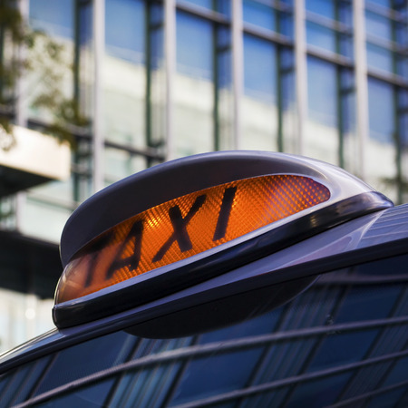 taxi sign: Taxi sign on Cab in Canary Wharf, London