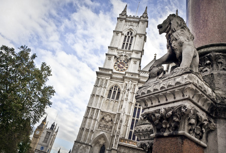 typically english: Westminster Abbey is the traditional coronation and burial site for English monarchs. Big Ben in the background.