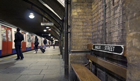 Baker Street subway station, people waiting for the arriving train. Stock Photo