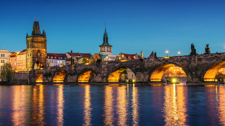 st charles: Pargue, view of the Lesser Bridge Tower of Charles Bridge at dusk Karluv Most, Czech Republic.