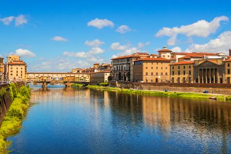 river arno: Florence, Ponte Vecchio bridge over river Arno and Palazzo Vecchio (Tuscany, Italy) Stock Photo