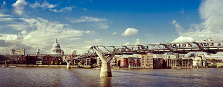 St. Pauls cathedral and the Millennium bridge (London, England). Stock Photo