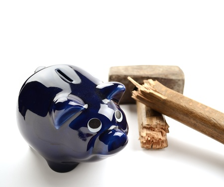 Piggy Moneybox With Sledge Hammer on White Background photo