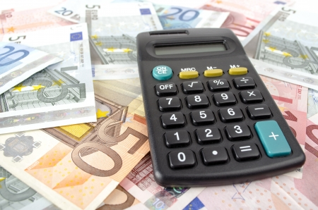 banknotes: calculator and euro banknotes abstract business background Stock Photo