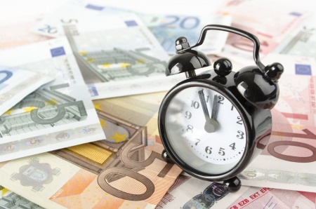 clock and euro banknotes abstract business background photo