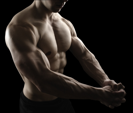 Muscular male body on black background studio shoot Stock Photo - 19286866