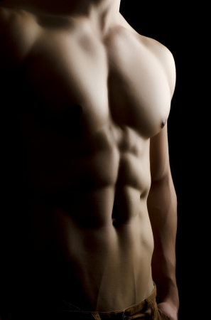 Muscular man body on black background studio shoot photo
