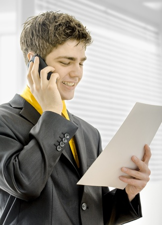businessman with mobile phone and papers in hand Stock Photo - 19670954