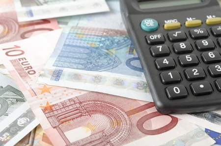 economic growth: calculator and euro banknotes