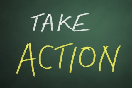 take action: Take action words on chalkboard background