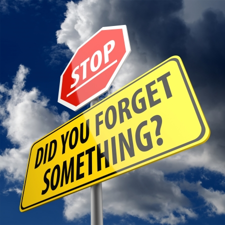 Did You Forget Something words on yellow Road Sign and Stop sign Stock Photo