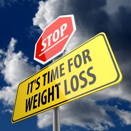 Stop it is time for weight loss words on road sign Stock Photo