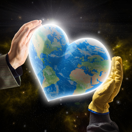 Hands of businessman and worker holding heart-shaped Planet Earth photo