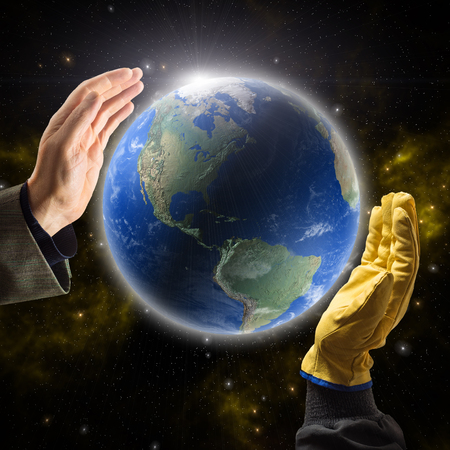Hands of businessman and worker holding Planet Earth photo