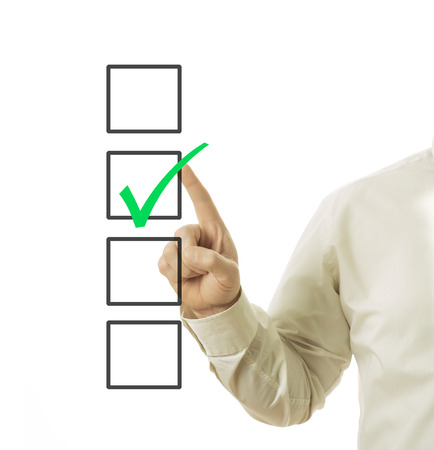 check box: businessman hand and checkbox with green mark in it
