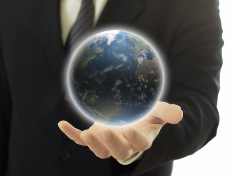 businessman holding earth globe in hand photo