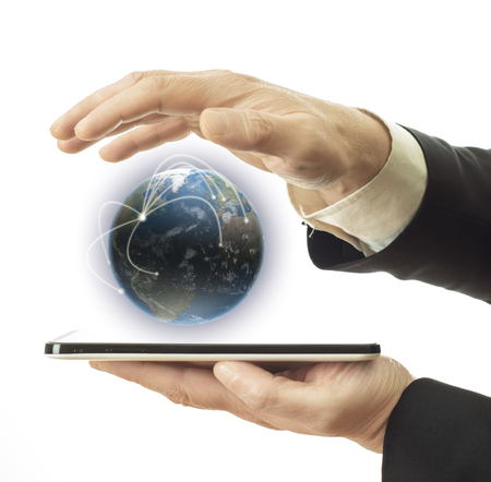 businessman holding tablet and earth globe in hands photo
