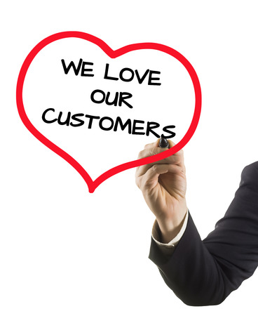 businessman hand with felt tip marker writing text we love our customers